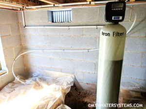Iron Filter Install in Candler Crawlspace