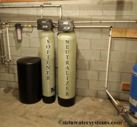 Happy family in Fairview with New Softener and Neutralizer