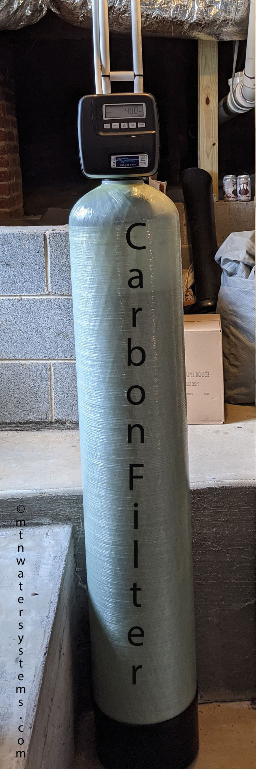 Asheville customer gets a carbon filter installed from Mountain Water Systems to remove that smelly chlorine taste and feel. Perfect Asheville city water now!